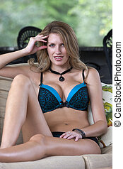 Outdoor Lingerie Model - Blonde model lounging in lingerie...