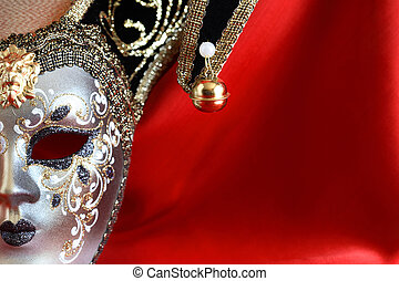 Mask On Red - Closeup of classical venetian mask on red silk...
