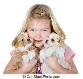 a girl holding two puppies