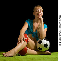 female soccer player with ball