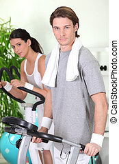 Couple working-out at the gym