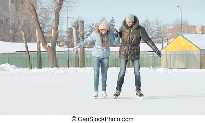 Learning how to skate - Guy helping his girlfriend to learn...