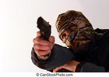 shooting gun - terrorist with ski mask shooting with a...
