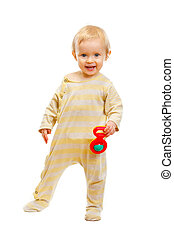 Lovely baby standing with rattle on white background