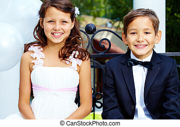Happy children - Portrait of boy groom and his cute bride...