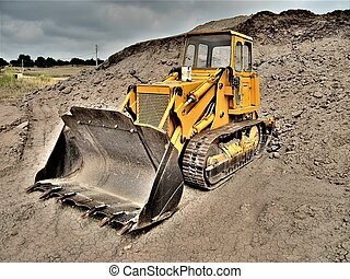 Bulldozer in dramatic landscape