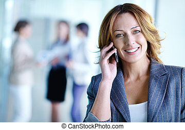 Business call - Image of pretty businesswoman calling on the...