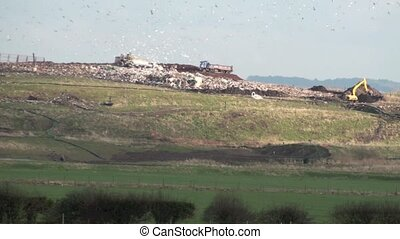 UK landfill site - Uk landfill site in action with machinery...