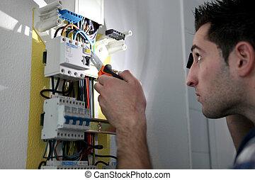 Man repairing fuse box