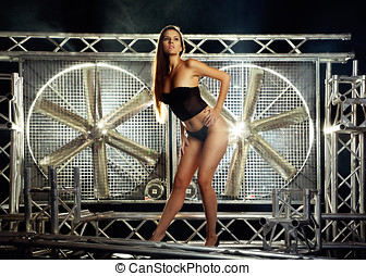 very sexy and beautiful top model on a stage posing with a...