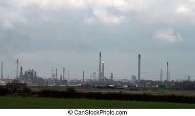 Factory Chimneys - Industrial plant with chimneys belching...