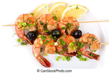 Barbecue with Tiger Prawns on a Skewer with Olives and Lemon...