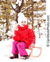 girl with a snowball - happy little girl sitting on the...