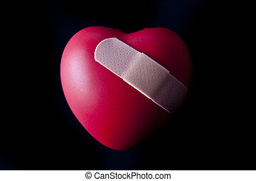 Broken Heart - A heart with a bandage across the front.