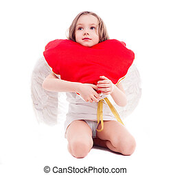 girl with a pillow - cute six year old girl dressed as a...