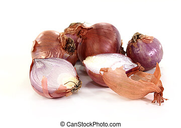 shallots - Shallots and peel on a white background