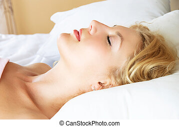 beautiful sleeping woman - profile of a beautiful young...