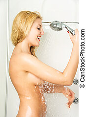 happy girl taking a shower - beautiful happy young blond...
