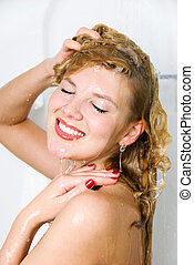 pretty woman washing her hair - pretty young woman taking a...