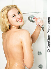 pretty girl taking a shower - happy beautiful young woman at...