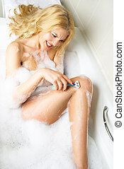 angry girl shaving legs - angry young woman taking a bath...