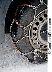Rusty snow chain on a cars tyre