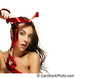 beautiful woman with a red ribbon on white background