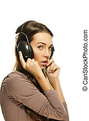 shy woman with headphones on white background