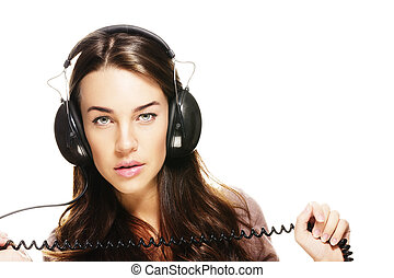 beautiful woman with headphones holding cord on white background