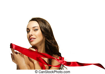 beautiful woman holding red ribbon with her finger on white background
