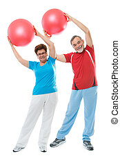 Senior couple in gym - Senior couple doing fitness exercise...
