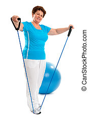 Senior woman in gym - senior woman doing exercises with a...