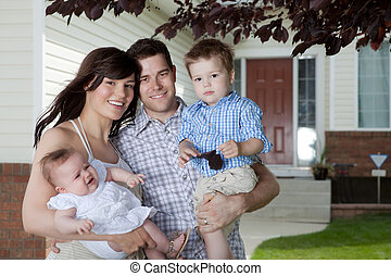 Young Family Portrait - Portrait Of Sweet Family Standing In...