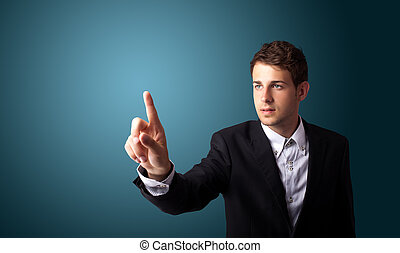man pressing an imaginary button on bokeh - Businessman...