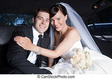Happy Wedding Couple in Limo - Portrait Of Newlywed Couple...
