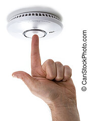 testing a domestic smoke detector - hand with pointing...
