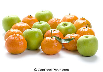 clementine oranges and granny smith apples isolated on a...