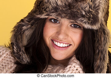 Woman keeping warm - A portrait of an attractive woman...