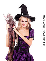 witch with a broom - pretty sexy young blond witch with a...
