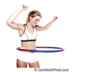 Fitness woman. - A young blond woman doing exercise with a...