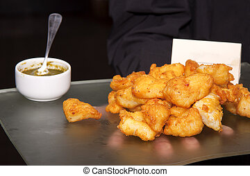 Fish snack - A pile of small battered and deep-fried fish...