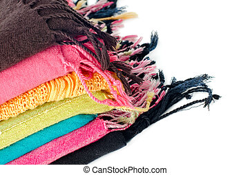 Pile of colorful scarves over white background