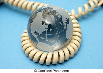 Global Communications - A globe and phone cord represent...