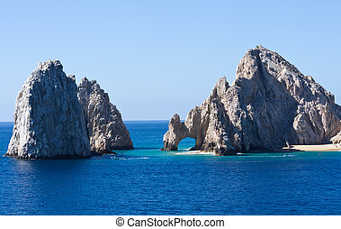 Striking Rock formations including El Arco rise from the sea