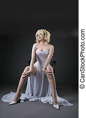 Sexy woman in white fashion dress sit on chair