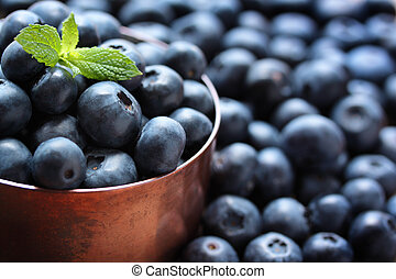 Blueberries - Fresh, ripe blueberries in a copper measuring...