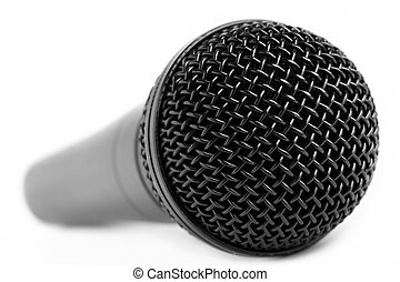Microphone - A black dynamic vocal microphone on a white...