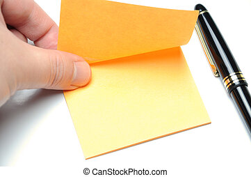 Tearing adhesive note - Man tearing yellow adhesive note