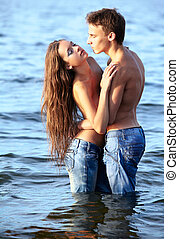couple at the beach - outdoor portrait of beautiful romantic...