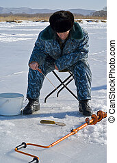 Winter fishing 58 - A man on winter fishing on ice of river.